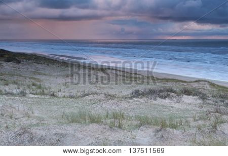 showers over North sea at sunset Netherlands