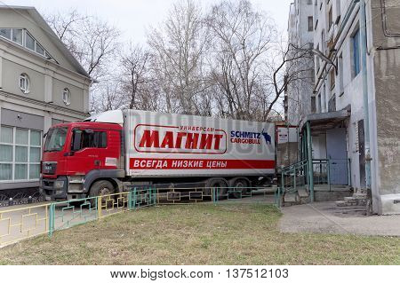 Nizhny Novgorod Russia. - April 14.2016. Cargo fura drove backwards to the rear entrance of the store MAGNET unloading goods. Street Sovnarkomovskaya 26.