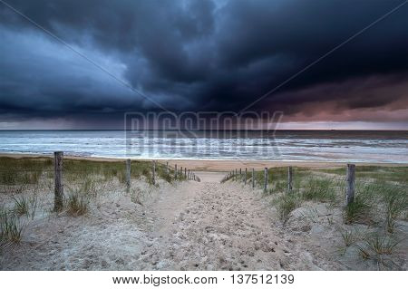 dark stormy clouds over North sea Netherlands