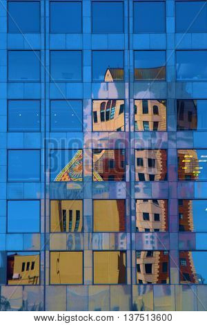 July 12, 2016 in Los Angeles, CA:  Modern skyscraper windows with the reflection of the Los Angeles Library and the Biltmore Highrise Building where tourists can sightsee and visit taken in Downtown Los Angeles, CA