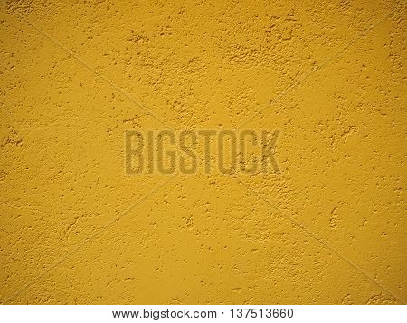 Detail of a wall of olive color with a rough cement surface for backgrounds
