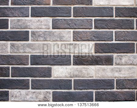 Detail of decorative brickwork close-up of white and black bricks to be used as background