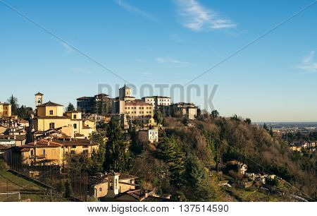 View over Citta Alta or Old Town buildings in the ancient city of Bergamo, Lombardia, Italy on a clear day, taken from San Virgilio point