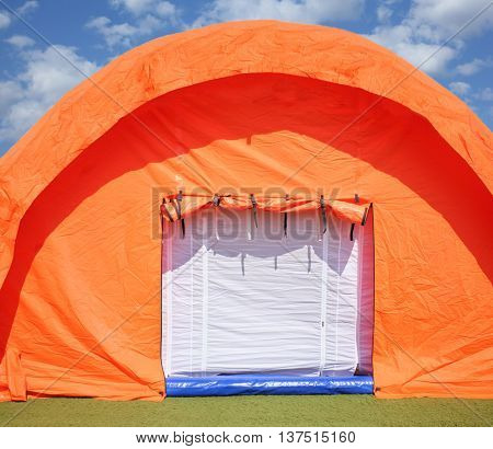Orange pneumoframe modular tent in a field hospital at the stadium