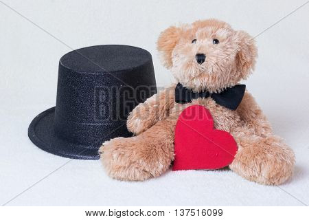 teddy bear with bow tie red heart and the black hat