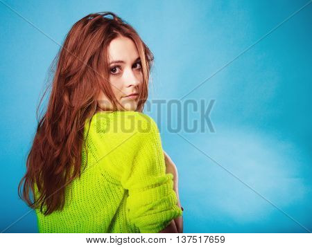 People teenage concept. Portrait young fashion woman teen girl wearing vivid colour sweater on blue