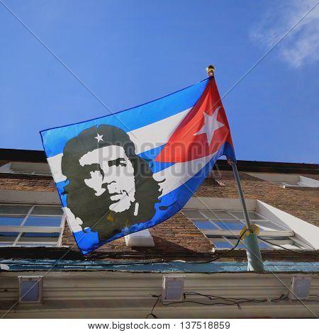 Che Guevara portrait on the flag of Cuba