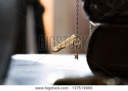 Key to Happiness - gold key on a chain, the Bible and inscription. Religion, Christianity, Orthodoxy idea.