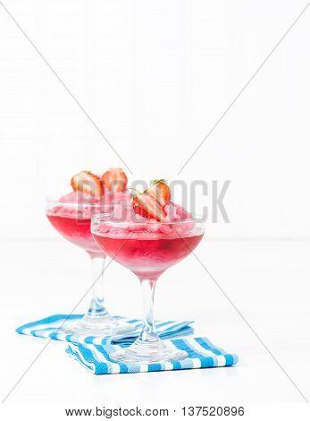 Frozen strawberry drink garnished with fresh berries.