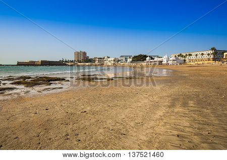 Old bathhouse on the beach of 'La Caleta' one of the most famous sites in the city of Cadiz Spain