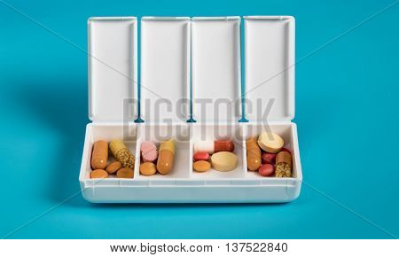 Tablets and capsules in the dispenser