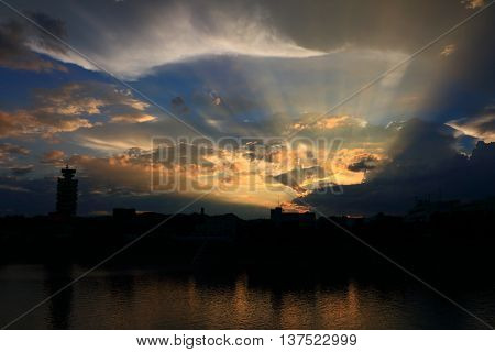 Clouds lit by sunset with Tyndall effect on Yangtze River, Yichang, China