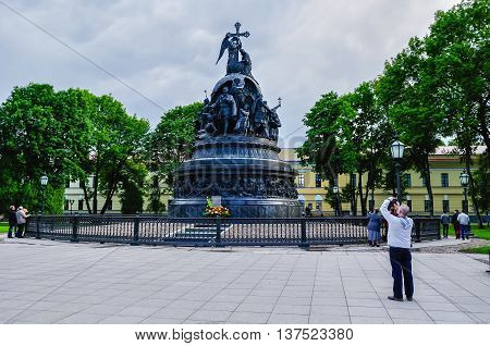 VELIKY NOVGOROD RUSSIA -JUNE 11 2016. Unidentified tourist taking the shot of the monument Millennium of Russia - famous bronze monument dedicated to Russia's 1000 year anniversary