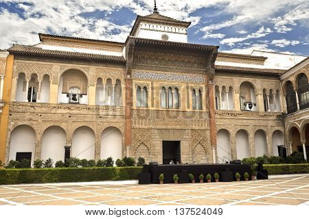 SEVILLE, SPAIN - September 12, 2015: View of King Peter of Castile Palace from the Patio de la Monteria Alcazar of Seville on September 12, 2015 in Seville, Spain