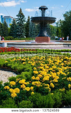 YEKATERINBURG RUSSIA - AUGUST 24 2013. Fountain in the city arboretum exhibition in summer sunny day in Yekaterinburg Russia