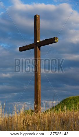 Crucifix on hill near Okrisky town in summer evening