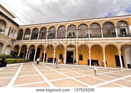 SEVILLE, SPAIN - September 12, 2015: View of the House of Trade (Casa de Contratacion) and the Patio de la Monteria in the Alcazar of Seville on September 12, 2015 in Seville, Spain