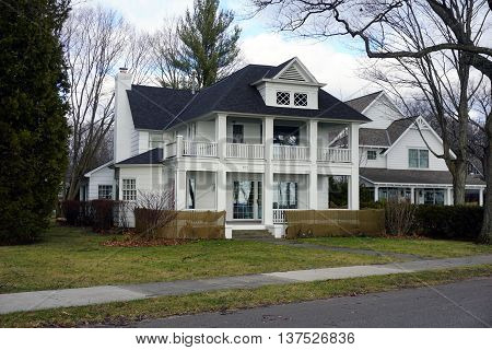 HARBOR SPRINGS, MICHIGAN / UNITED STATES - DECEMBER 25, 2015: An elegant colonial style home on East Bluff Drive in Harbor Springs.
