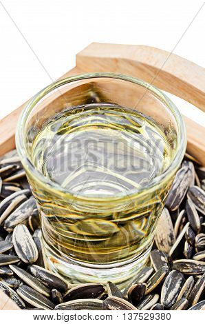 The Sunflower Oil with seeds on wooden