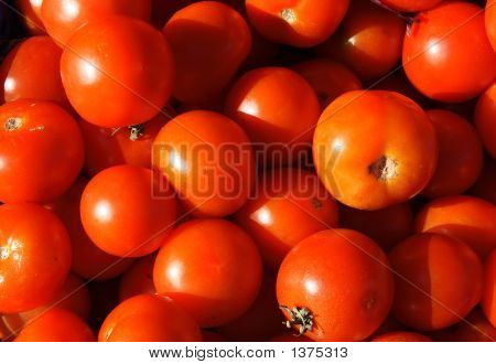 Red Tomatoes In A Market Stall, Cornwall, Uk.