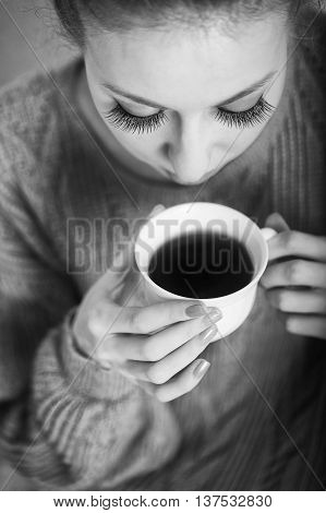 Pretty young ballerina tea drinkers. Close-up portrait. Black and white photography