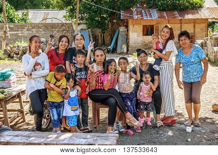 Tangkoko Indonesia- Dec 25 2015: Big Indonesian family. Tangkoko National Park. North Sulawesi