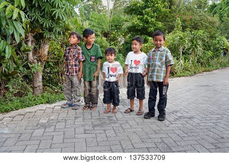 Indonesian Boys On The Street In Village
