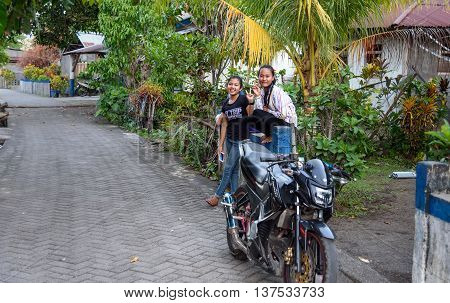 Indonesian Girls On The Street In Village
