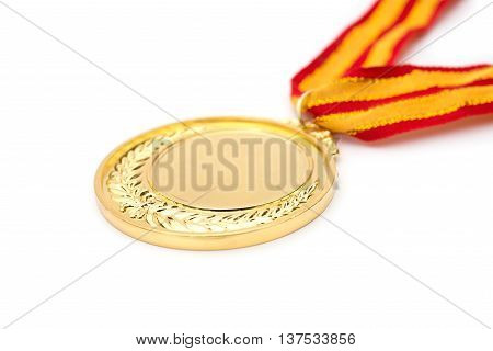 a gold medal on a white background