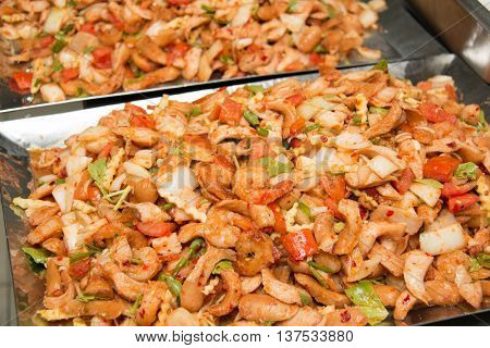 Thai Spicy salad with sausage shrimp and vegetables on dish