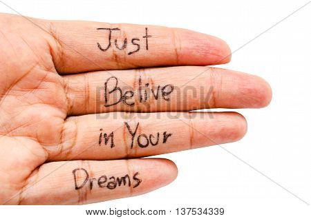Just belive in your dreams word on finger isolated on white background Saved clipping path.