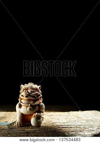 Chinese lion. Netsuke of a lion of a Buddha. Netsuke of a lion