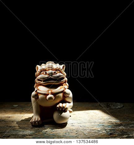 Chinese lion. Netsuke of a lion of a Buddha. Netsuke of a lion
