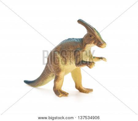 brown Parasaurolophus toy on a white background