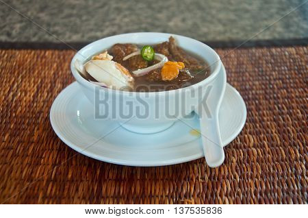 gruel and salted egg on wood table