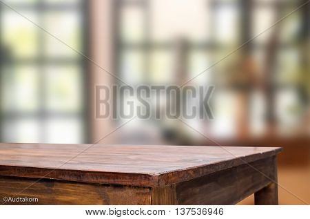Selected focus empty brown wooden table and Coffee shop blur background with bokeh image for product display montage