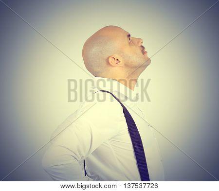 Bald Man Looking Up.