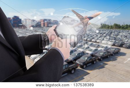 hand presses on world map with digital tablet,Business success strategy plan on container and car yard background (Elements of this image furnished by NASA)