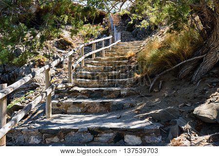 Stony steps with wooden railings on Crete island, Greece