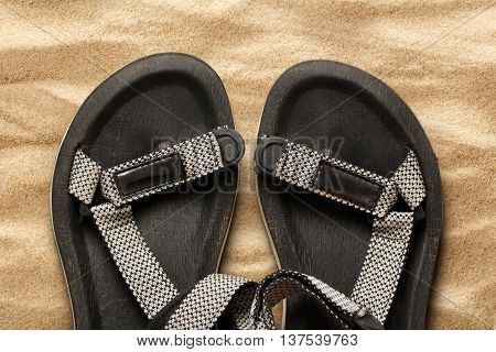 Male Beach Sandals On Sand Background