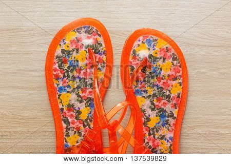 Female Beach Sandals On Wooden Background