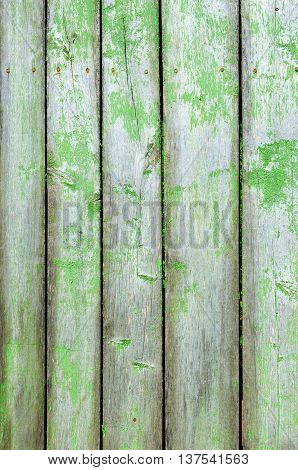 Old wooden fence with cracked green paint background image