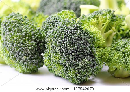 A close up of a Broccoli florets on white background selective focus.