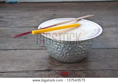 incense and candle for give alms to a Buddhist monk