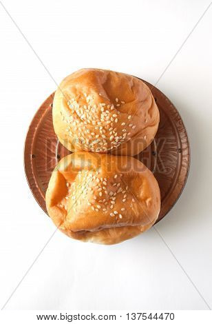 delicious bun with sesame seeds isolated on white