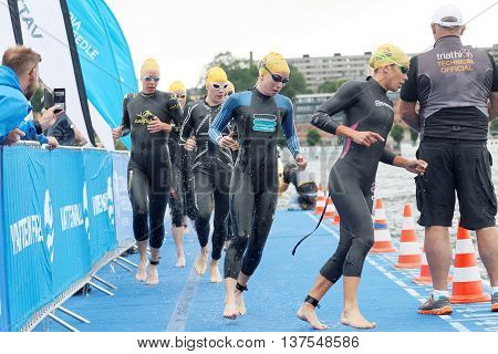 STOCKHOLM - JUL 02 2016: Many female swimmer climbing up from the water in the Women's ITU World Triathlon series event July 02 2016 in Stockholm Sweden