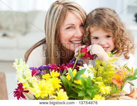 Young girl with her grandmother looking at the camera