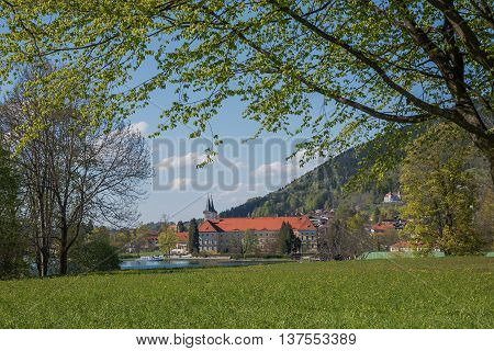 Idyllic Tegernsee Castle And Brewery, View Through Green Branches