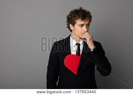 Handsome Man In Shuit Holding A Heart In Hands