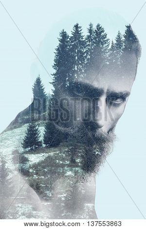Bearded guy in double exposure photo of mountains. Surreal art concept